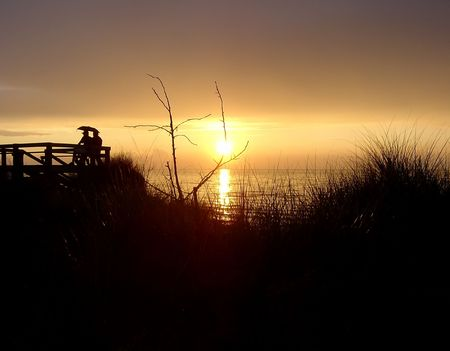 pinery: A beautiful sunset with people silhouetted, shot at Lake Huron in the Pinery. Stock Photo