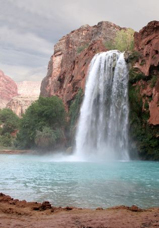 canyon walls: A view of the havasu waterfall within the grand canyon. Stock Photo