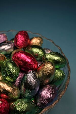 foil: A bowl of foil chocolate Easter eggs.