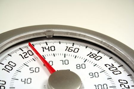 A close up of a weight scale set at 128.