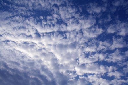 pillowy: A blue sky with puffy white clouds in and interesting pattern.