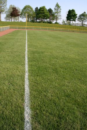 A shot of left field on a baseball diamond.