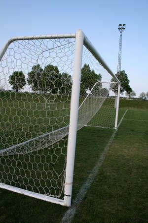 goalline: A closeup of a soccer goal shot down the goalline. Stock Photo