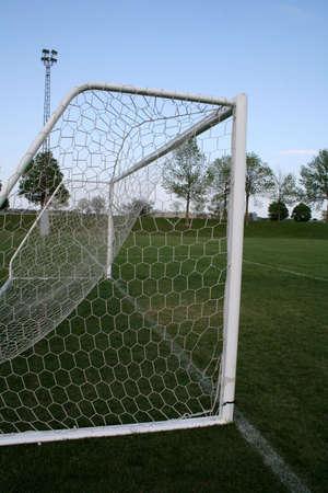goalline: A shot of a soccer goal from behind the goal.
