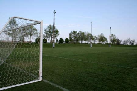 goalline: An empty soccer pitch.