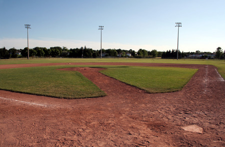 A view of a baseball diamond at dusk. photo