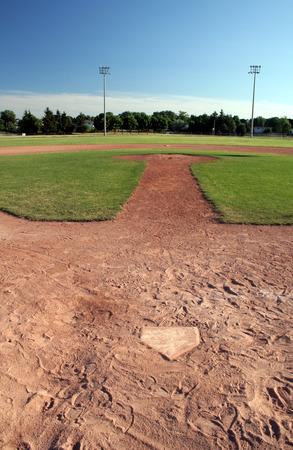 A view of a baseball diamond at dusk.