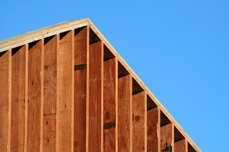The wooden frame of a large new house. Stock Photo
