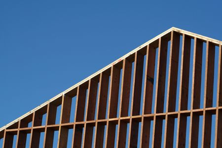 2x4: The wooden frame of a large new house. Stock Photo
