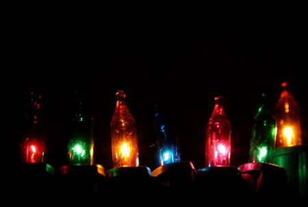 A line of multi-colored lit Christmas lights.