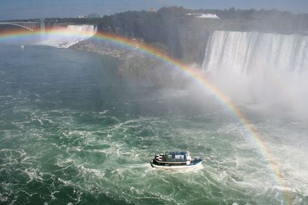 The Maid of the Mist in the swell near Niagara Falls with a rainbow over head.
