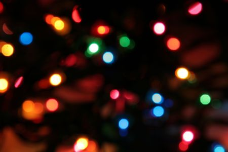 Lit Christmas lights strand deliberately blurred to give an interesting look. Stock Photo - 2083846