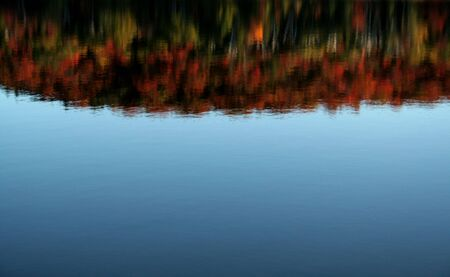 The reflection of the beautiful autumn colors on a lake of Algonquin Park in Ontario, Canada. photo