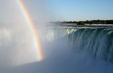 A rainbow shot against the fog of Niagara Falls.