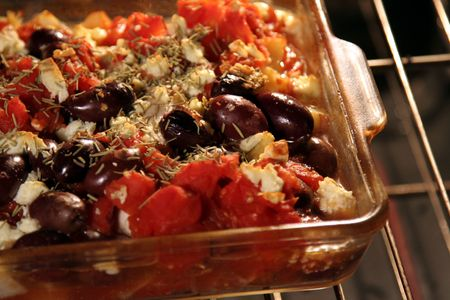cloesup: A Greek Casserole in the Oven and cooking in a dish.