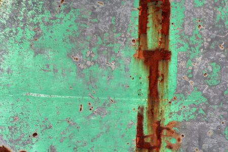 rust covered: A rough grey sign closeup covered in green and rust. Stock Photo