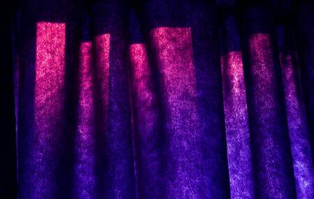 A closeup of funky purple blue curtains.