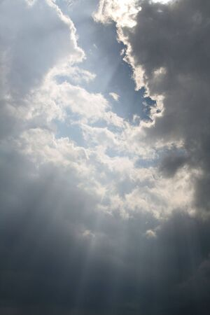 Beams of sunlight bursting through the clouds.