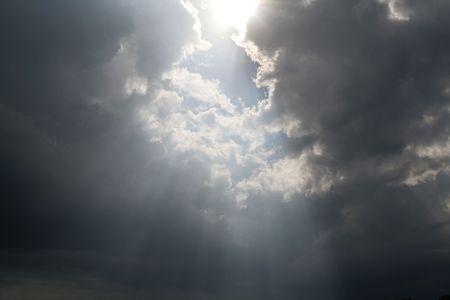 Beams of sunlight bursting through the clouds.