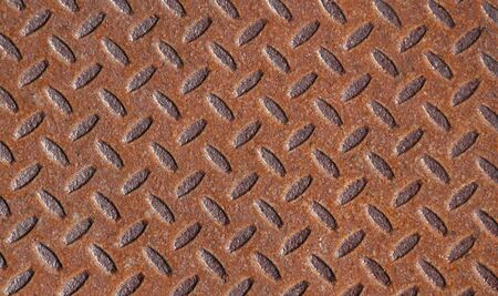 metal grate: A rusted metal with a grate pattern.