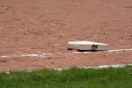 hardball: A closeup of first base.