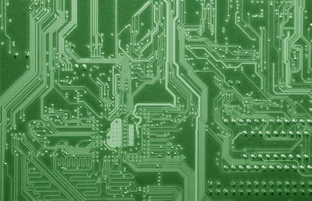 A macro shot of a green circuit board. photo