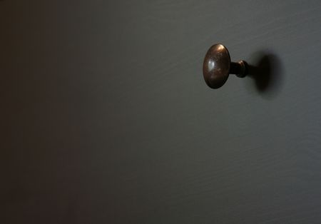 A closeup of a single drawer knob. Banco de Imagens