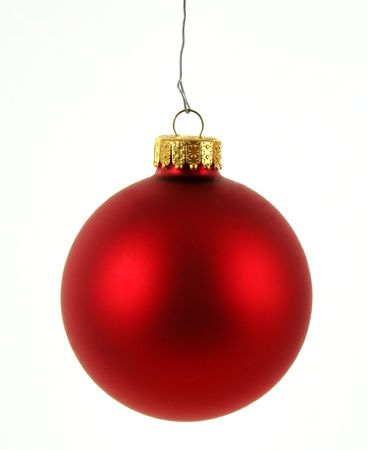 A single isolated red Christmas bauble hanging.