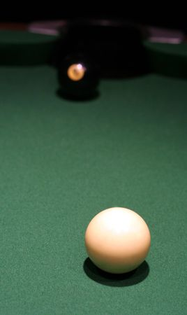 eight ball: The eight ball sitting right in front of the pocket with the white ball well positioned.