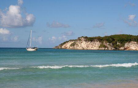 docked: A sailboat docked at a tropical beach, near Punta Cana Dominican Republic.