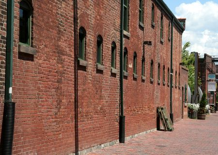 many windows: An old brick warehouse and brick road.