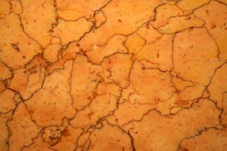 tile flooring: Close-up of orange marble tile.