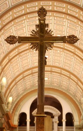 hymn: A golden cross inside the Cathedral of Mary, Queen of the World, in Montreal, Quebec, Canada.
