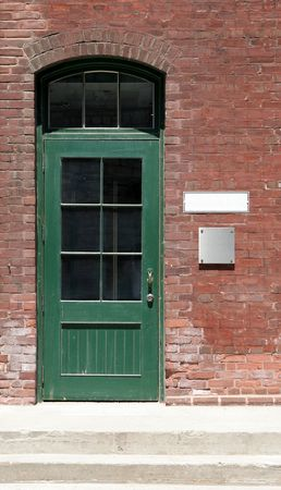 warehouse building: The green door of an old antique shop door.
