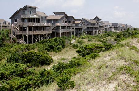 A row of beach houses on the beach at Outer Banks, North Carolina, USA.