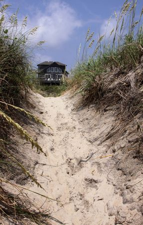 A beach house framed by the sand dunes in the Outer Banks, North Carolina.