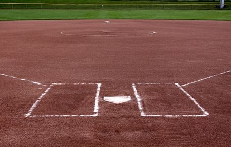 hardball: The view from behind the plate on a vacant softball field. Stock Photo
