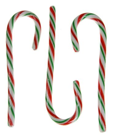 A bunch of candy canes isolated on white. photo
