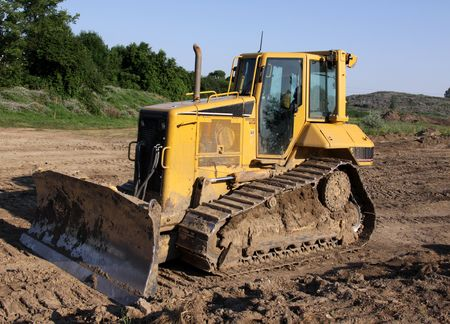 site: A small bulldozer at a construction site.