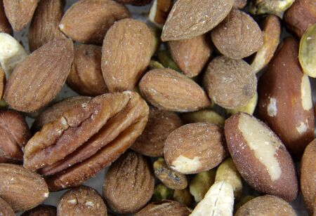mixed nuts: A close-up of mixed nuts, featuring walnuts, almonds, hazelnuts, and brazil nuts. Stock Photo
