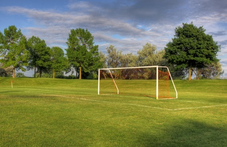 bounds: An empty soccer goal with trees in the background Stock Photo