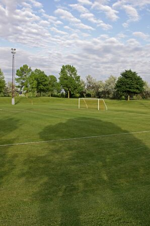 A cloudy unoccupied soccer field with trees in the background a cloudy unoccupied soccer field with trees in the background hdr photograph photo altavistaventures Gallery