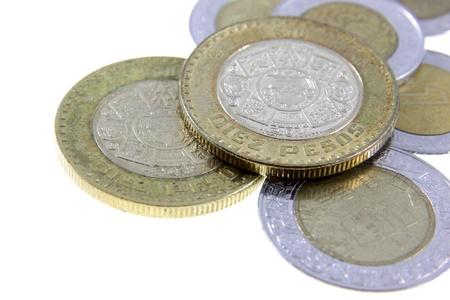 Een close-up shot van een stel Mexicaanse munten.