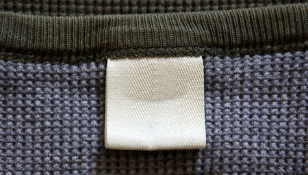 gray clothing: A blank label on a shirt. Stock Photo