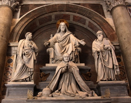 A sculpture in St. Peter's basilica featuring Jesus, Saint Paul, Saint Peter and a pope.