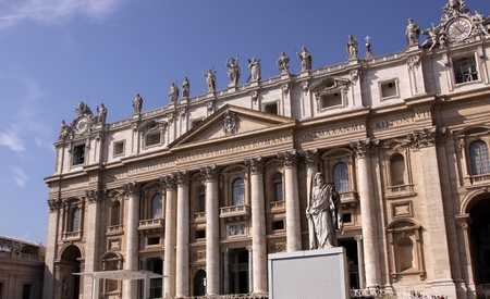 The front of St. Peters Basilica, in Vatican city.  Featuring the imposing statue of Saint Paul.