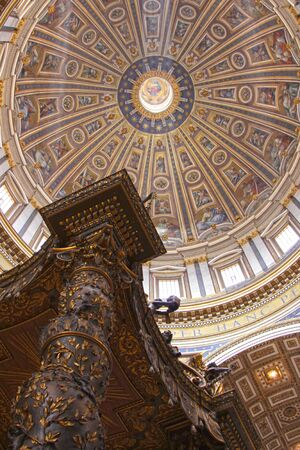 peters: The dome of St. Peters Basilica with the top of the baldachin in the bottom of the frame.