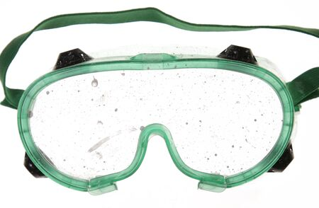 Goggles with paint drips on the lens.