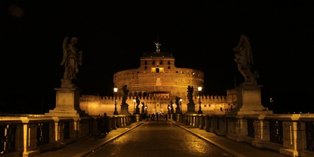 The towering Castel SantAngelo (Mausoleum of Hadrian) in Rome, Italy.  Shot at night from Ponte Sant Angelo.  Redakční