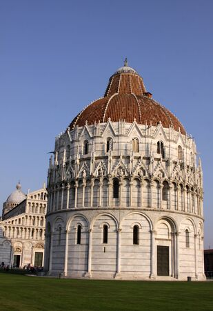 The Baptistry and cathedral in the Piazza del Duomo, in Pisa, Tuscany, Italy.